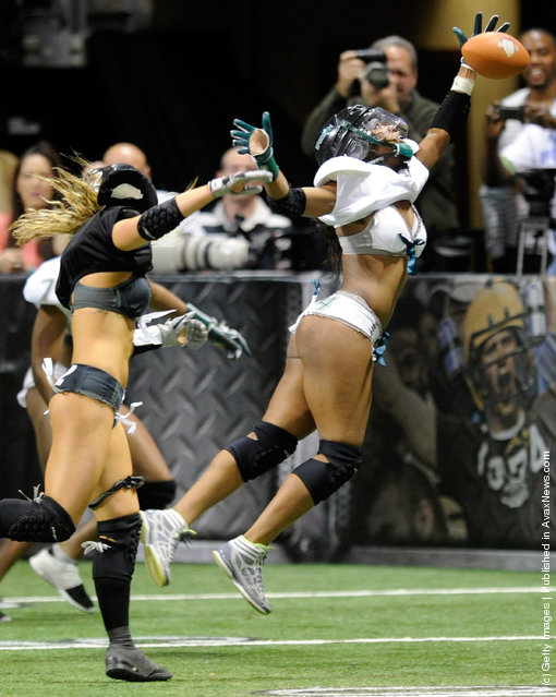 Jaleesa McCrary #14 of the Philadelphia Passion can't pull down a pass against the Los Angeles Temptation during the Lingerie Football League's Lingerie Bowl IX at the Orleans Arena