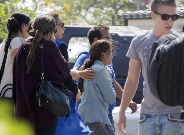 Relatives of passengers on a vanished EgyptAir flight grieve as they leave the in-flight service building where they were held at Cairo International Airport, Egypt, Thursday, May 19, 2016. Egyptian aviation officials say an EgyptAir flight from Paris to Cairo with 66 passengers and crew on board has crashed. The officials say the search is now underway for the debris. (Photo by Amr Nabil/AP Photo)