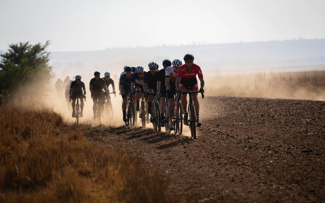 The leading riders race on the dusty dirt roads during the inaugural SouthxSoutheast gravel fondo bicycle race on the open dirt roads south of Johannesburg, South Africa, 20 October 2019. Gravel bicycles are similar to road bikes but have wider off road tryes and disk breaks and have become very popular on South Africa with its 450,000km of dirt roads. (Photo by Kim Ludbrook/EPA/EFE/Rex Features/Shutterstock)