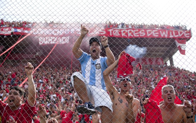 Independiente's fans celebrate their team's fourth goal during an Argentine league soccer match against Racing Club in Buenos Aires, Argentina, Saturday April 14, 2012. (Photo by Natacha Pisarenko/AP Photo)