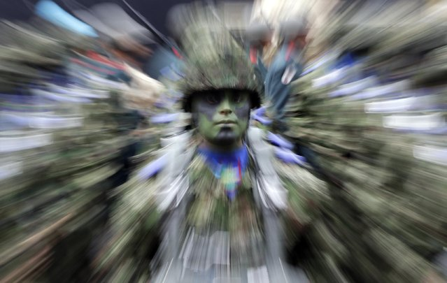 A Colombian soldier stands in formation during a military parade celebrating his country's 205th anniversary of independence from Spain, in Bogota, Colombia, Monday, July 20, 2015. (Photo by Fernando Vergara/AP Photo)
