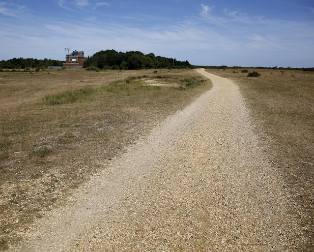 A gravel path lies on the former Royal Air Force base of Greenham Common, England, July 15, 2013.  REUTERS/Chris Helgren