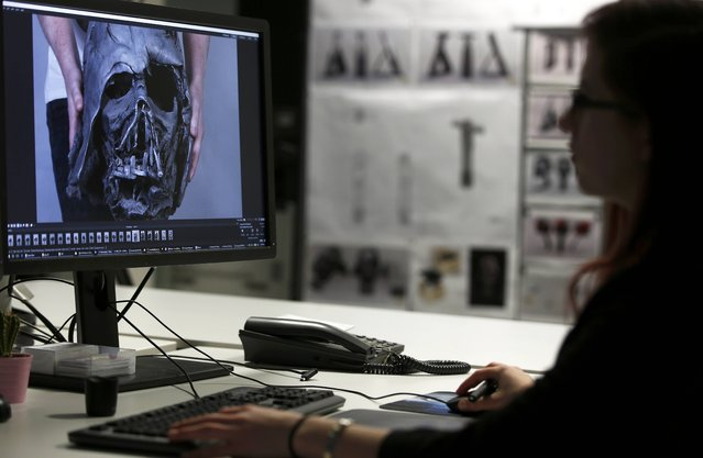 "A member of the digital team works on Darth Vader's melted helmet from ""Star Wars: The Force Awakens"", in the Propshop headquarters at Pinewood Studios near London, Britain May 25, 2016. (Photo by Peter Nicholls/Reuters)"