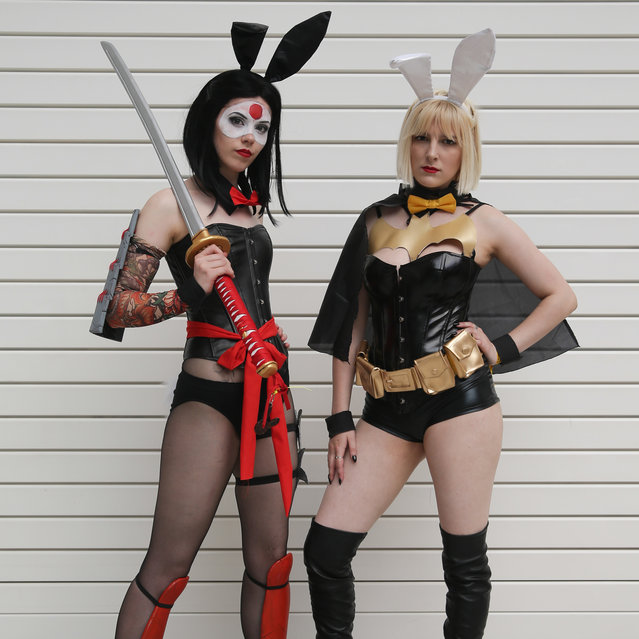 "Jadene (L) as ""Katana"" and Katie as ""Batgirl"" from the DC cosplay bunnies, pose together for a photograph on the second day of the London ""MCM Comic Con"" at the ExCel centre in east London, on May 27, 2017. (Photo by Daniel Leal-Olivas/AFP Photo)"