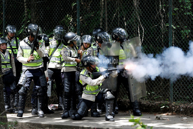 A riot police fires tear gas towards demonstrators during a protest called by university students against Venezuela's government in Caracas, Venezuela, June 9, 2016. (Photo by Carlos Garcia Rawlins/Reuters)