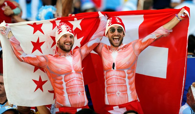 Swiss supporters cheer before the start of the World Cup round of 16 soccer match between Argentina and Switzerland at the Itaquerao Stadium in Sao Paulo, Brazil, Tuesday, July 1, 2014. (Photo by Frank Augstein/AP Photo)