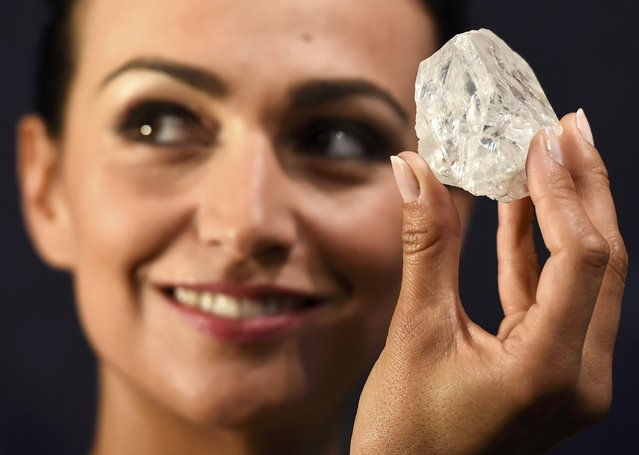 "A model shows off the 1109 carat ""Lesedi La Rona"", the largest gem quality rough diamond discovered in over 100 years during a sale preview at Sotheby's auction house in London, Britain, June 14, 2016. (Photo by Dylan Martinez/Reuters)"