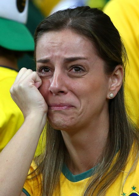 A dejected Brazil fan looks on during the 2014 FIFA World Cup Brazil Semi Final match between Brazil and Germany at Estadio Mineirao on July 8, 2014 in Belo Horizonte, Brazil. (Photo by Robert Cianflone/Getty Images)
