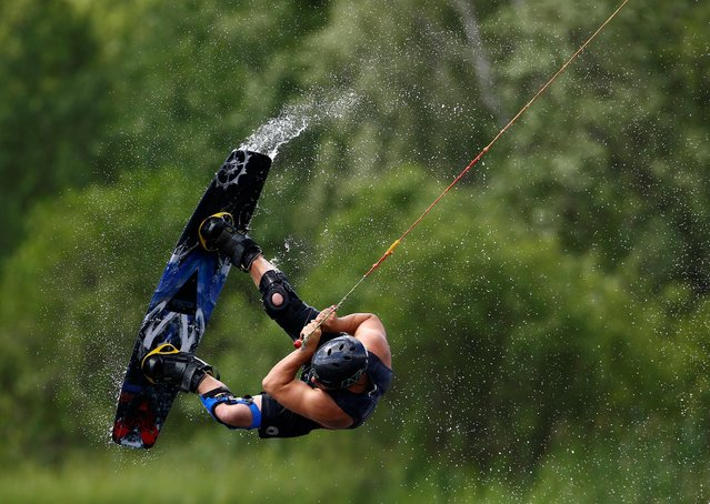A man takes part in Belarus Wakeboard Cup in Minsk, Belarus June 18, 2016. (Photo by Vasily Fedosenko/Reuters)