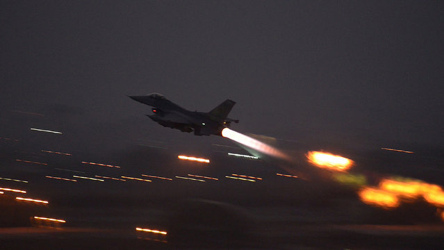 In this image provided by the U.S. Air Force, an F-16 Fighting Falcon takes off from Incirlik Air Base, Turkey, as the U.S. on Wednesday, August 12, 2015, launched its first airstrikes by Turkey-based F-16 fighter jets against Islamic State targets in Syria, marking a limited escalation of a yearlong air campaign that critics have called excessively cautious. (Photo by Krystal Ardrey/U.S. Air Force via AP Photo)