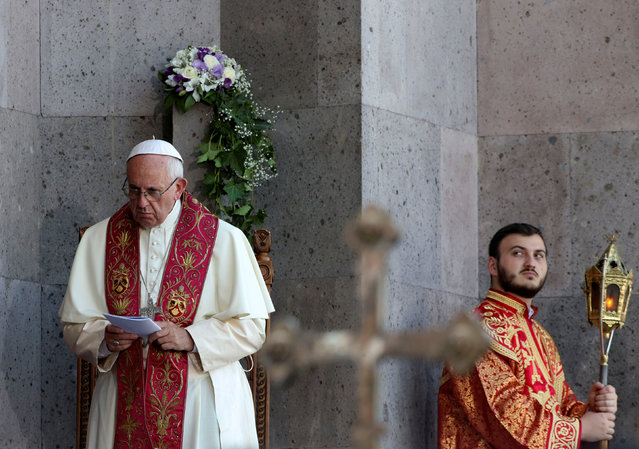 Pope Francis (L) attends as a member of Armenian Church (R) looks on during the Divine Liturgy at the Armenian Cathedral in Etchmiadzin, Armenia, June 26, 2016. (Photo by Alessandro Bianchi/Reuters)