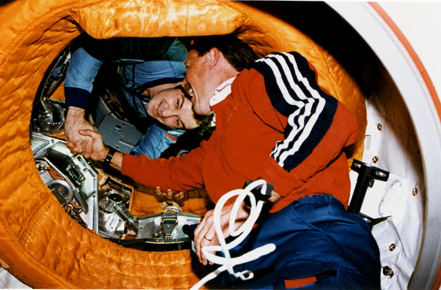 Astronaut Robert L. Gibson, STS-71 mission commander, shakes the hand of cosmonaut Vladimir N. Dezhurov, Mir-18 commander. The historic handshake took place two and a half weeks prior to the 20th anniversary of a similar in-space greeting between cosmonauts and astronauts participating in the Apollo-Soyuz Test Project (ASTP). On July 17, 1975, astronaut Thomas P. Stafford, NASA's ASTP commander, greeted his counterpart, Aleksey A. Leonov, in a docking tunnel linking the Soyuz and Apollo spacecraft. (Photo by NASA)