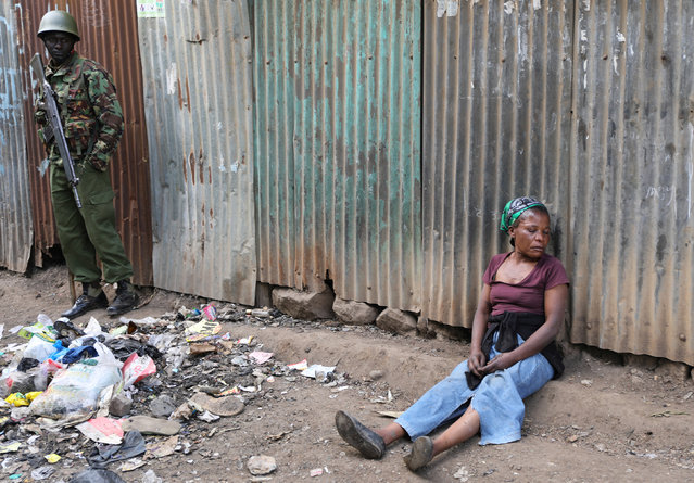 A woman cries after a supporter of opposition leader Raila Odinga was killed by police, as witnesses claimed, in Mathare slum in Nairobi, Kenya, August 9, 2017. (Photo by Marius Bosch/Reuters)