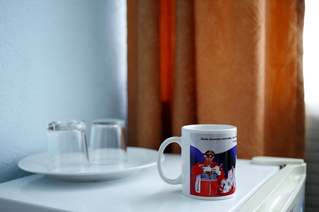 """A mug decorated with pictures of Russian President Vladimir Putin, which reads """"People should understand that a healthy way of life is a personal success of each and every of us"""", is seen in this photo illustration taken in a hotel room in Kazan, Russia, July 30, 2015. (Photo by Stefan Wermuth/Reuters)"""