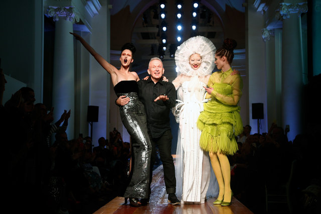 French fashion designer Jean Paul Gaultier, second from left, acknowledges applause with models at the end of his Haute Couture Fall-Winter 2016-2017 fashion collection presented Wednesday, July 6, 2016 in Paris. (Photo by Thibault Camus/AP Photo)