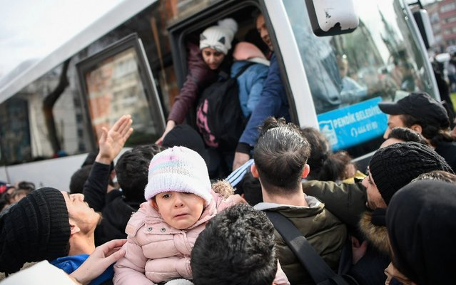 Syrian refugees board a bus as they head to border villages of Edirne province, in Istanbul, Turkey, 28 February 2020. The Turkish government announced its decision to no longer stop refugees from reaching Europe, after 33 Turkish soldiers were killed in Idlib, Syria on 27 February. (Photo by Akin Celiktas/EPA/EFE/Rex Features/Shutterstock)