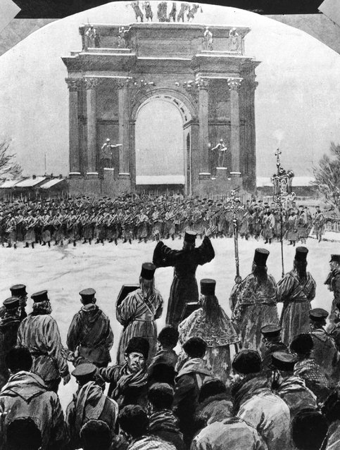 """Father Gapon and his followers are suddenly faced by troops outside the Winter Palace in St Petersburg, during the Revolution of 1905 on """"Bloody Sunday"""", 22nd January 1905. Gapon was leading a procession of workers to lay its demands before Tsar Nicholas II.  In the ensuing massacre 70 were killed and 200 wounded."""