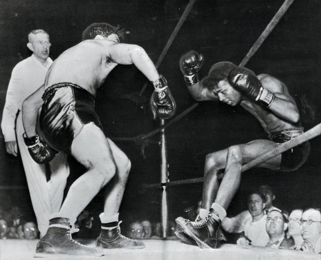 Victorious in 129 successive fights, including 40 as a pro, Ray Robinson falls through the ropes of a ring, under the impact of Jake LaMotta's fists on Olympia Stadium, Detroit, Michigan on February 5, 1943. Robinson got back in the ring, but lost the decision in ten rounds. LaMotta pummelled him for the rest of the fight, winning via a unanimous decision, giving Robinson the first defeat of his career.They fought again just 21 days later when Robinson regained his mantle winning in another 10-round fight, Robinson won the close fight by a unanimous decision. LaMotta stated the bout was gifted to Robinson because he would be inducted into the army the next day. (Photo by Bettmann Archive/Getty Images)