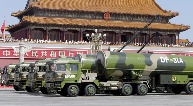 Military vehicles carrying DF-31A long-range missiles drive past the Tiananmen Gate during a military parade to mark the 70th anniversary of the end of World War Two, in Beijing, China, September 3, 2015. (Photo by Jason Lee/Reuters)