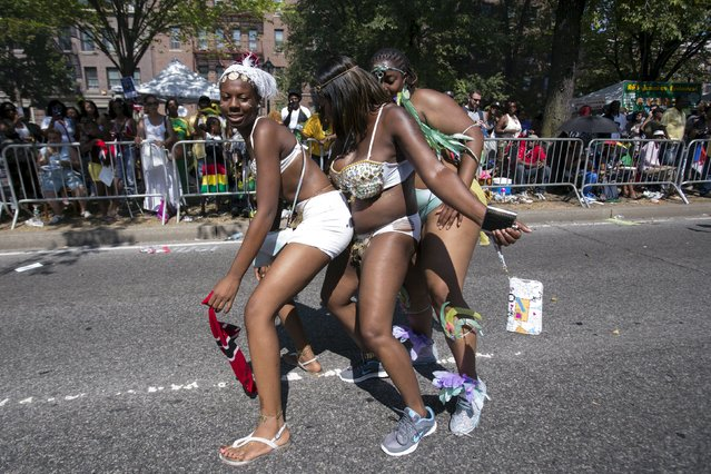 Participants dance during the West Indian Day Parade in Brooklyn, New York September 7, 2015. (Photo by Andrew Kelly/Reuters)