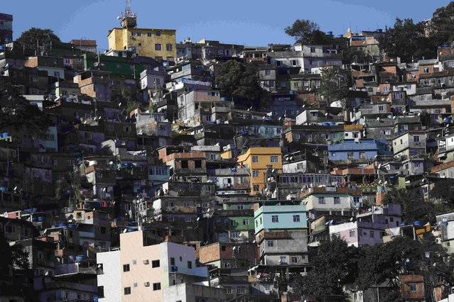 """A general view of the Rocinha favela, one of the slums that was included in the """"police pacification unit"""" program that began in 2008, in Rio de Janeiro, Brazil, July 24, 2016. Picture taken July 24, 2016. (Photo by Bruno Kelly/Reuters)"""