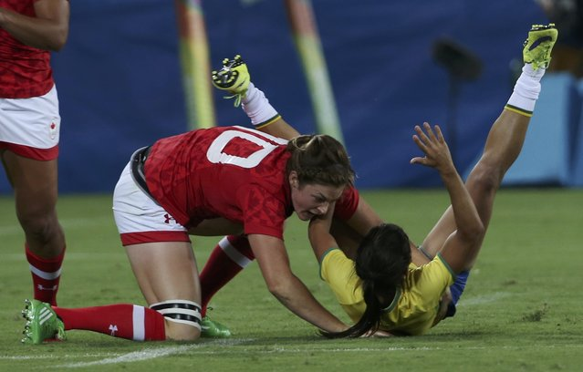 2016 Rio Olympics, Rugby, Preliminary, Women's Pool C Canada vs Brazil, Deodoro Stadium, Rio de Janeiro, Brazil on August 6, 2016. Amanda Araujo (BRA) of Brazil is tackled by Hannah Darling (CAN) of Canada. (Photo by Alessandro Bianchi/Reuters)