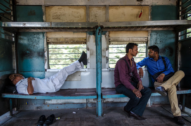 Indian passengers travel on a local train in New Delhi, India, October 2017. (Photo by Ankur Dutta/Barcroft Media)