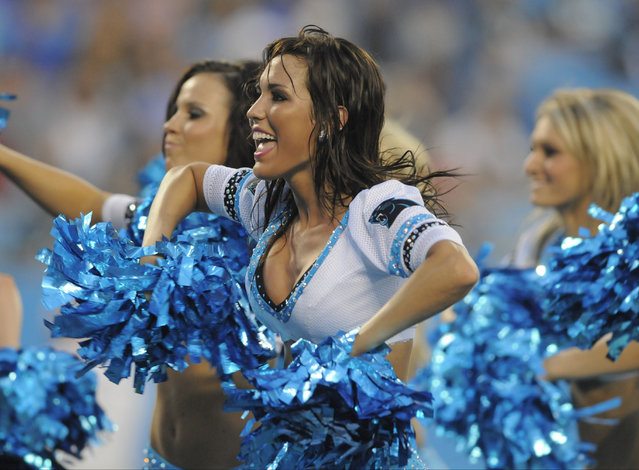 Carolina Panthers cheerleaders perform during the first half of a preseason NFL football game against the Buffalo Bills in Charlotte, N.C., Friday, August 8, 2014. (Photo by Mike McCarn/AP Photo)