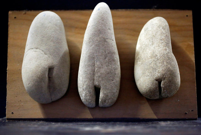 Stones collected and categorised by shape (female genitalia) are seen at the home workshop of Luigi Lineri in Zevio, near Verona, Italy, June 10, 2016. (Photo by Alessandro Bianchi/Reuters)