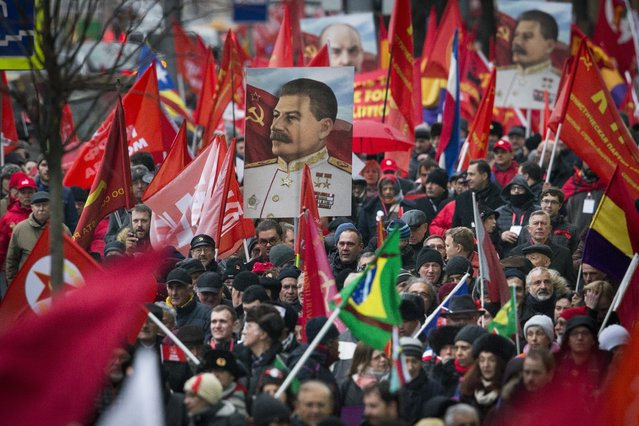 Communist party supporters carry portraits of Soviet founder Vladimir Lenin, rear centre, and Soviet dictator Josef Stalin during a demonstration marking the 100th anniversary of the 1917 Bolshevik revolution in Moscow, Russia, Tuesday, November 7, 2017. (Photo by Alexander Zemlianichenko/AP Photo)