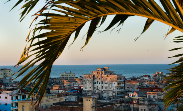 The ocean and Havana are pictured from an Old Havana rooftop. (Photo by Sarah L. Voisin/The Washington Post)