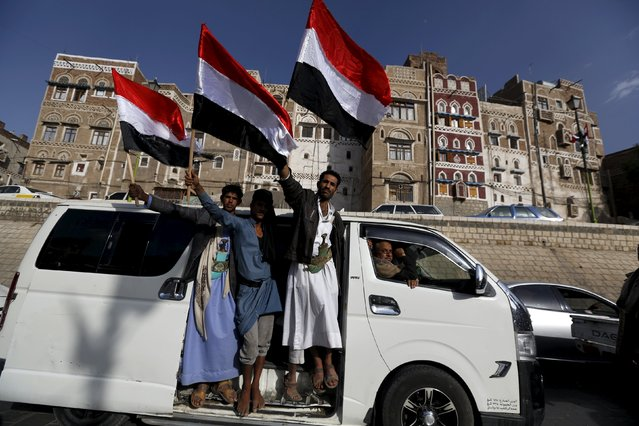 Houthi followers wave Yemen's national flag as they ride a van to a ceremony marking the first anniversary of their movement's takeover of the capital Sanaa September 21, 2015. (Photo by Khaled Abdullah/Reuters)