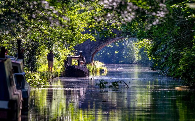 A couple enjoy the hot weather on their canal boat on Bridgewater Canal in Walton Hall, Cheshire on June 25, 2020, as Thursday could be the UK's hottest day of the year with scorching temperatures forecast to rise even further. (Photo by Peter Byrne/PA Wire/PA Images via Getty Images)