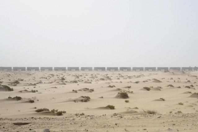 A SNIM train carrying iron ore arrives in Nouadhibou, Mauritania, June 26, 2014. (Photo by Joe Penney/Reuters)