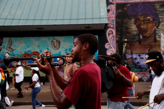 A man plays the trumpet during a march and Second Line to commemorate the 15th anniversary of Hurricane Katrina, in New Orleans, Louisiana, U.S. August 29, 2020. (Photo by Shannon Stapleton/Reuters)