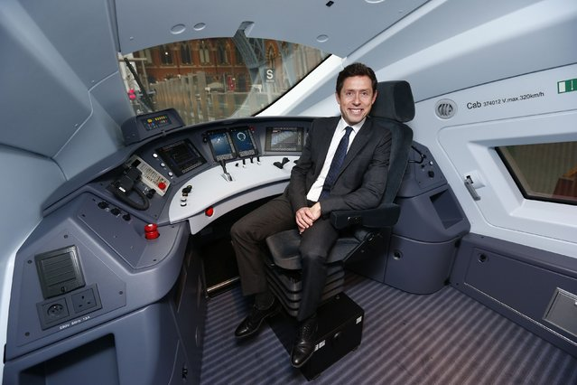 Nicolas Petrovich, CEO of Eurostar, poses in the driver's cab of their new Siemens e320 train at St Pancras station in central London, November 13, 2014. (Photo by Andrew Winning/Reuters)