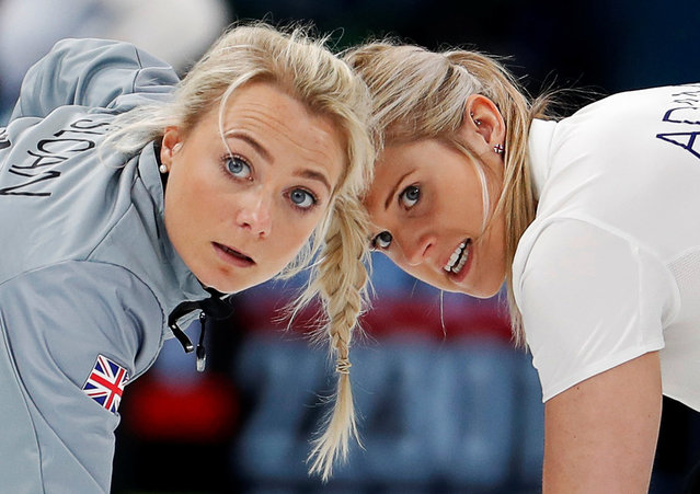 Anna Sloan and Vicki Adams of Britain sweep during a match against Olympic Athletes from Russia in Session 1 of the Women' s Round Robin curling competition at the 2018 Winter Olympic Games at Gangneung Curling Centre in Gangneung, South Korea on February 14, 2018. The British team won the match convincingly, 10-3. (Photo by Cathal McNaughton/Reuters)