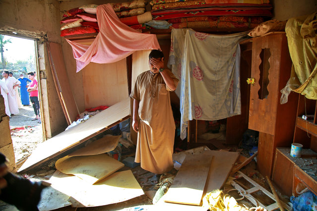 A man inspects the aftermath of a deadly Katyusha rocket attack inside his home near the international airport in Baghdad, Iraq, Tuesday, September 29, 2020. Several Iraqi civilians were killed and two severely wounded Monday after the Katyusha rocket hit near Baghdad airport, Iraq military said. It was the first time in months an attack caused civilian casualties. (Photo by Khalid Mohammed/AP Photo)