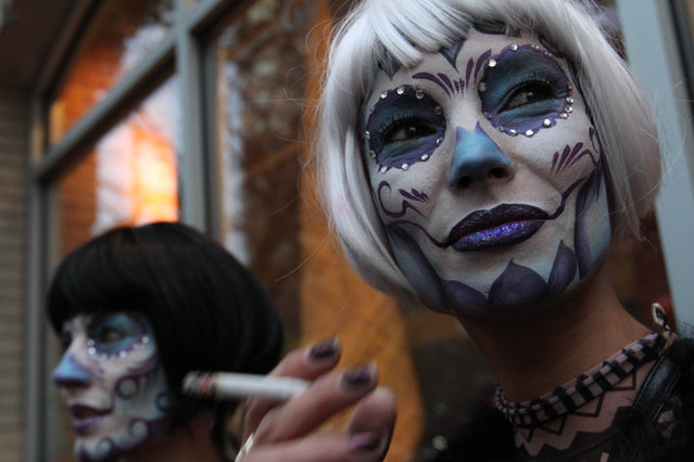 Angele Blank, right, and Virginia Promeyrat wait for the start of the Greenwich Village Halloween Parade, Saturday October 31, 2015, in New York. (Photo by Tina Fineberg/AP Photo)