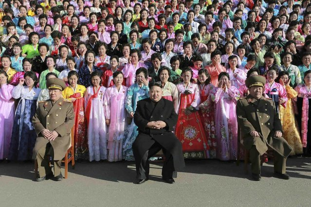 North Korean leader Kim Jong Un poses during a photo session with participants in the Second Meeting of KPA Exemplary Servicemen's Families in this undated photo released by North Korea's Korean Central News Agency (KCNA) in Pyongyang December 9, 2014. (Photo by Reuters/KCNA)