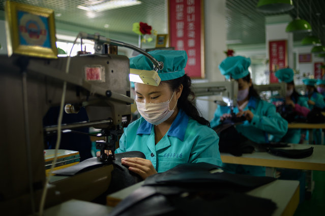 In a photo taken on October 28, 2020 an employee of the Wonsan Leather Shoes Factory makes leather shoes, in North Korea's eastern port city of Wonsan, Kangwon Province. (Photo by KIM Won Jin/AFP Photo)