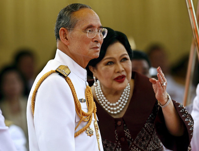 A file picture dated 30 April 2007 shows Thai King Bhumibol Adulyadej (L) and Queen Sirikit during a launching ceremony of a new navy coast patrol ship at Thai Royal Navy Shipyard, Bangkok, Thailand. (Photo by Rungroj Yongrit/EPA)