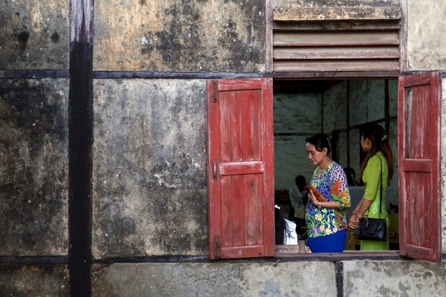 A woman is seen at a polling station while casting her vote during the general election in Sittwe November 8, 2015. Voting began on Sunday in Myanmar's first free nationwide election in 25 years, the Southeast Asian nation's biggest stride yet in a journey to democracy from dictatorship. (Photo by Sai Aung Min/Reuters)