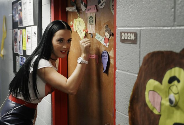 Singer Katy Perry canvasses for Democratic presidential nominee Hillary Clinton in a dorm at the University of Nevada, Las Vegas, Saturday, October 22, 2016, in Las Vegas. (Photo by John Locher/AP Photo)