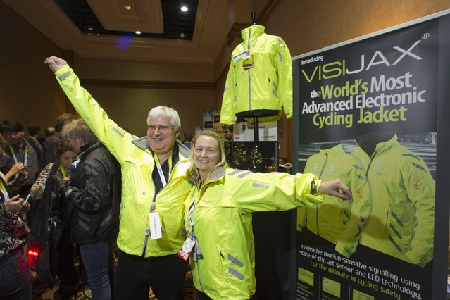 Mark Bernstein (L) and Angela Cairns model VISIJAX, an electronic cycling jacket, during the 2015 International Consumer Electronics Show (CES) in Las Vegas, Nevada January 4, 2015. The jackets have 23 high intensity LEDs and a rechargeable battery that is removable if the jacket needs washing. (Photo by Steve Marcus/Reuters)