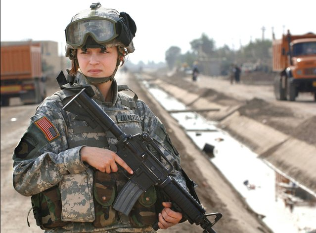 U.S. soldier Pfc. Janelle Zalkovsky, from civil affairs unit of 1st Battalion, 320th Field Artillery Regiment, 101st Airborne Division, provides security while other soldiers survey a newly constructed road in Ibriam Jaffes, Iraq in  this handout photo released on December 7, 2005. U.S. Defense Secretary Ash Carter on December 3, 2015 announced the U.S. military will open all combat jobs to women. (Photo by Reuters/U.S. Army)