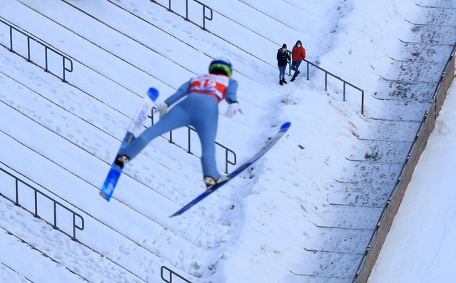 Spectators watch Austria's Stefan Kraft in action during the Viessmann FIS Ski Jumping World Cup Willingen on January 31, 2021 in Willingen, Germany. (Photo by Wolfgang Rattay/Reuters)