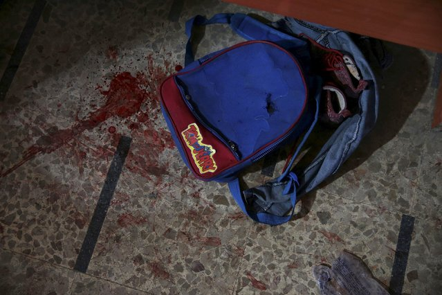 A school bag that belongs to an injured student lies on the floor inside a field hospital after after what activists said were air and missile strikes in the Douma neighborhood of Damascus, Syria December 13, 2015. (Photo by Bassam Khabieh/Reuters)