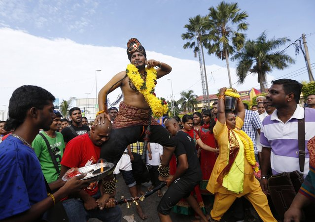 A Hindu devotee dances during his pilgrimage to the Batu Caves temple during Thaipusam in Kuala Lumpur February 3, 2015. (Photo by Olivia Harris/Reuters)