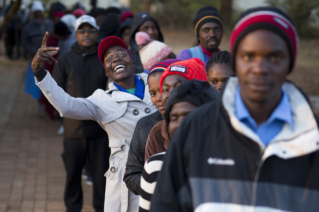 Zimbabweans line up to vote at the Fitchela primary school in Kwekwe, Zimbabwe, Monday, July 30, 2018. The vote will be a first for the southern African nation following a military takeover and the ousting of former longterm leader Robert Mugabe. (Photo by Jerome Delay/AP Photo)